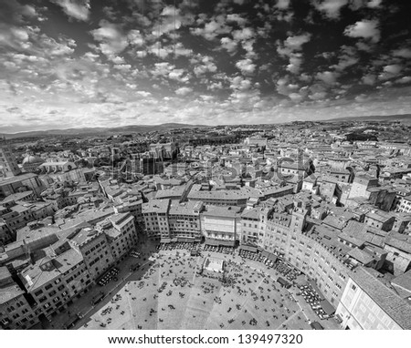 Wonderful aerial view of Piazza del Campo, Siena on a beautiful sunny day. - stock photo
