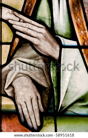 Wonderful ancient stained glass window formed of multiple colors - stock photo