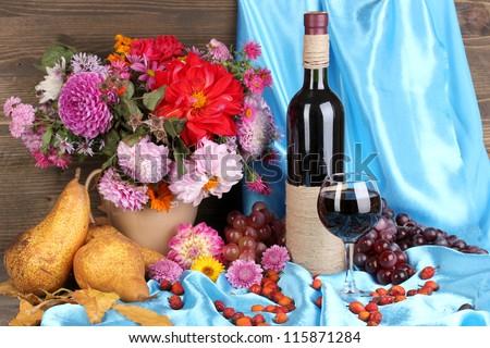 Wonderful autumn still life with fruit and wine - stock photo