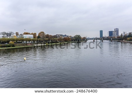 Wonderful autumn view of embankment of river Main from famous Eiserner Steg bridge. Frankfurt am Maine - financial center of Germany.