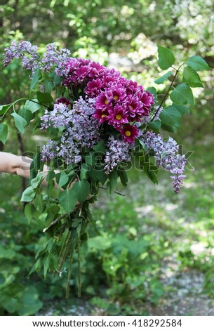 Wonderful bouquet from a lilac and chrysanthemums - stock photo