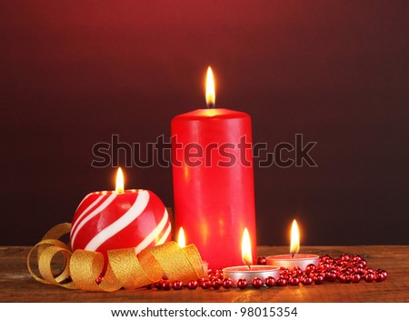 Wonderful candles on wooden table on dark background - stock photo