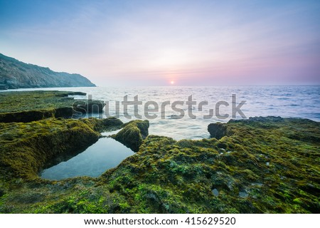 Wonderful dawn in calm waves with ancient coral rocks at Nui Chua national park, Ninh Thuan Province, Viet Nam, one of amazing landscape in Vietnam, masterpiece place for travel.
