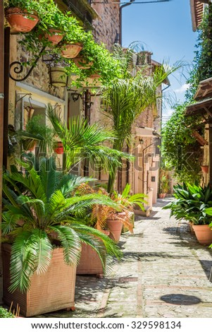 Wonderful decorated street in small town in Italy, Umbria - stock photo