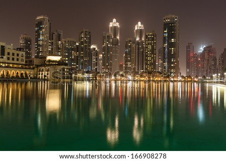 Wonderful Dubai skyscrapers and fountain at night