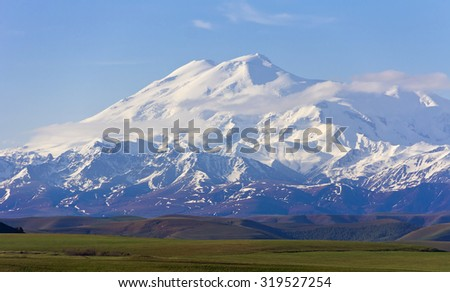 Wonderful Elbrus in light clouds. The Caucasus.