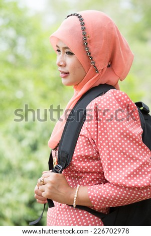 Wonderful  Female Asian college student standing wait for entry her class