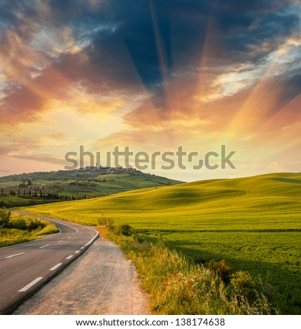 Wonderful fields with springtime sunset colors. - stock photo