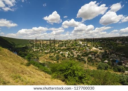 Wonderful green rural area of Orheiul Vechi under blue sky, Moldova - stock photo