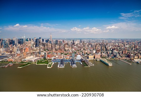 Wonderful helicopter view of Western Manhattan with Hudson river and skyscrapers - New York City. - stock photo