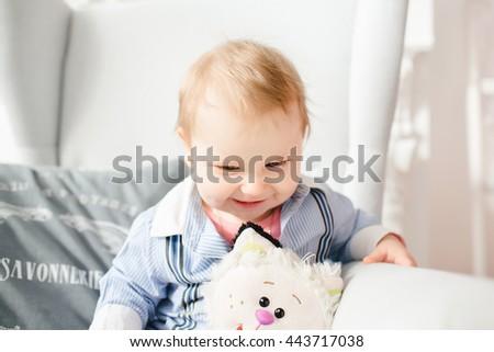 wonderful little boy playing with a toy - stock photo