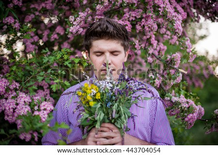 wonderful man holding a bouquet of colored flowers - stock photo