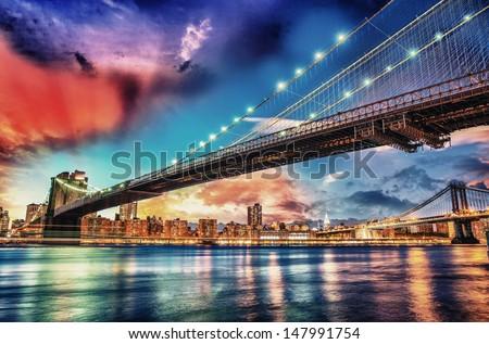 Wonderful panoramic sunset with Brooklyn and Manhattan Bridge - New York. - stock photo