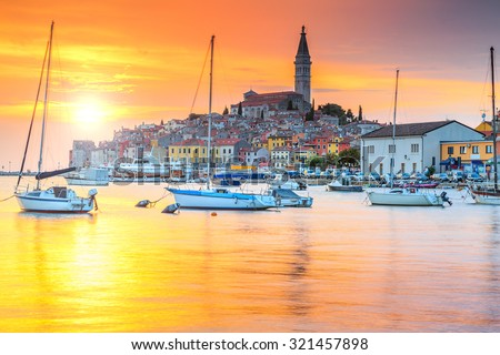 Wonderful romantic old town of Rovinj and famous fishing harbor with magical sunset,Istrian Peninsula,Croatia,Europe - stock photo