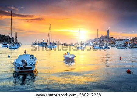 Wonderful romantic old town of Rovinj and famous fishing harbor with stunning sunset,Istrian Peninsula,Croatia,Europe - stock photo
