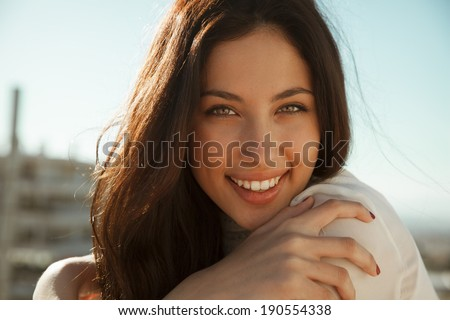 Wonderful smiling woman with a lovely look and bright make up. Natural young beauty. horizontal shot. outdoors - stock photo