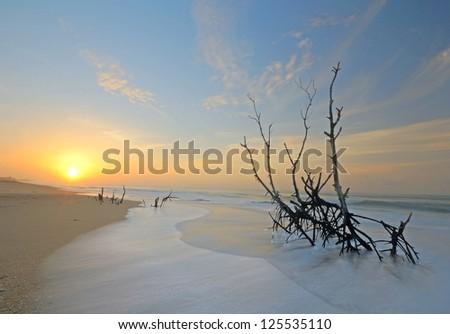 Wonderful sunset on Tangalla beach, Sri Lanka, blurred motion effects on waves - stock photo