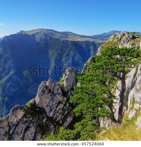 Wonderful view to mountains in the national park Durmitor. Montenegro Balkans Europe. Beauty world. Autumn Landscape in a blue sky. - stock photo