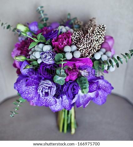 Wonderful violet wedding bouquet - stock photo
