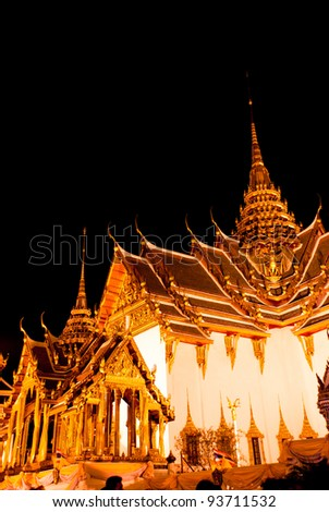Wonderful Wat Phra Kaew in the temple of the Emerald Buddha in Bangkok of Thailand at night. - stock photo