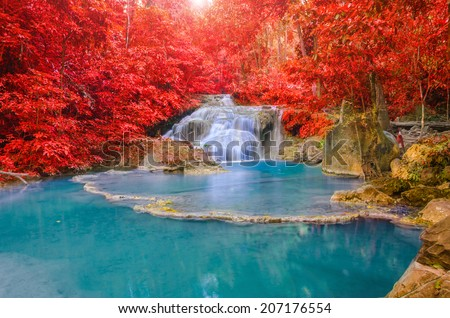 Wonderful Waterfall and red leaf in Deep forest at Erawan waterfall National Park, Kanjanaburi Thailand. - stock photo