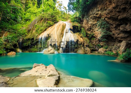 wonderful waterfall with colorful tree in thailand - stock photo
