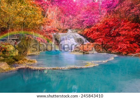Wonderful Waterfall with rainbows in deep forest at national park, Thailand. - stock photo