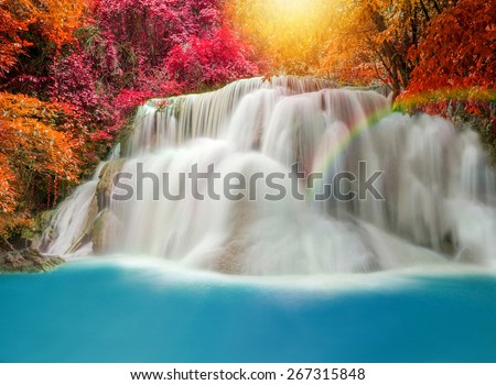 Wonderful Waterfall with rainbows in deep forest at national park, Thailand - stock photo