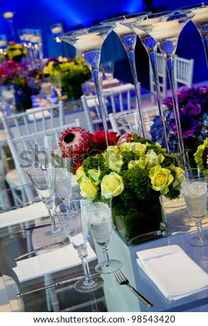 wonderful wedding decorations, with clear glass tables, flowers, and candles - stock photo