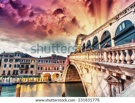 Wonderful wide angle view of Rialto Bridge on a cloudy sunset - Venice.