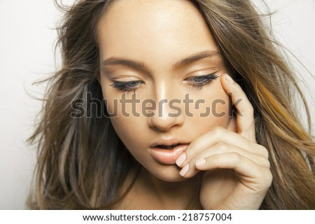 Wonderful woman with a lovely look and bright make up.Toned in warm colors. Horizontal shot. Studio - stock photo