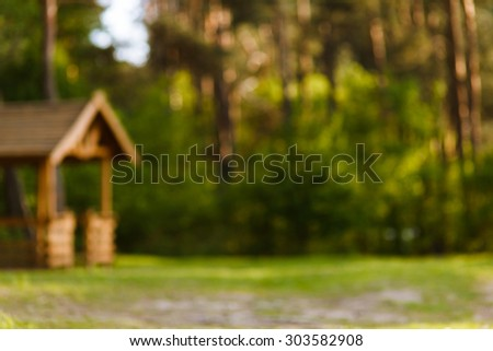 Wonderful, wooden gazebo in the woods intended for outdoor recreation. Wonderful nature, forest, trees. - stock photo