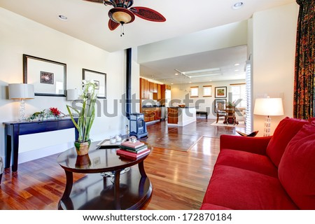 Wonderfully designed living room extended to a bright big kitchen room - stock photo