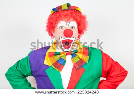 wondering clown on white background - stock photo