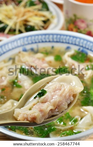 Wonton soup  in a bowl. Traditional asian food. - stock photo