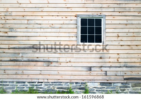 Wood and Stone Barn with Window - stock photo