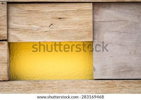 wood and yellow concrete wall texture - stock photo