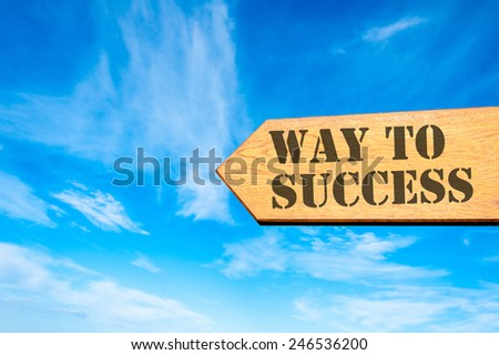 Wood arrow sign against clear blue sky with Way to success message, accomplishment concept  - stock photo