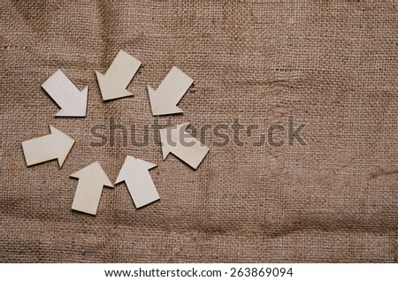 wood  arrow with tag on sack background - stock photo