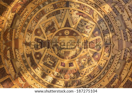 Wood Aztec solar calendar This handcrafted Aztec sun calendar is very detailed as to see the different rings signaling the days months and the 52 year cycle  - stock photo