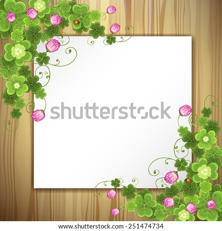 Wood background with clover - stock photo