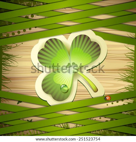 Wood background with clover and strips - stock photo