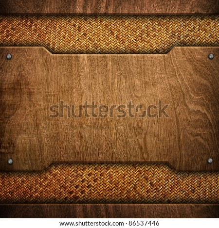 wood background with rattan - stock photo