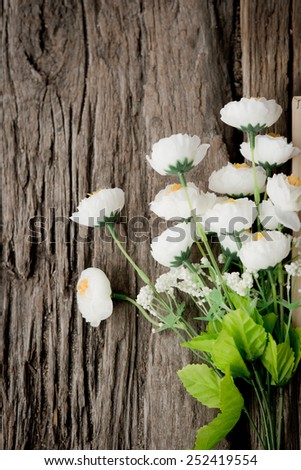 Wood background with spring flowers. - stock photo
