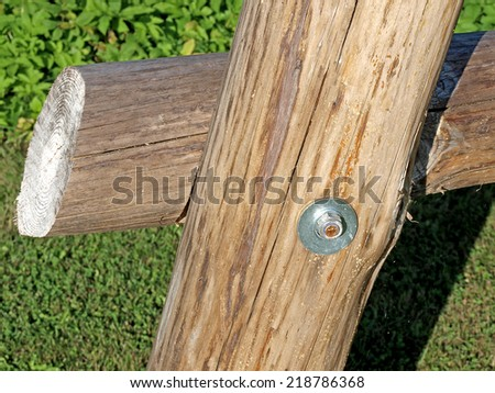 Wood beams connected by metal screw and nut - stock photo