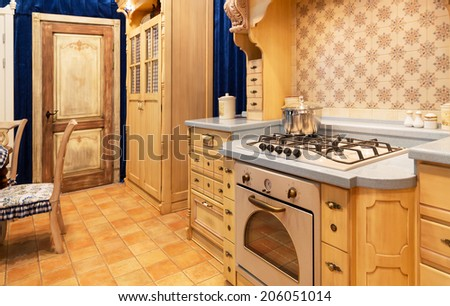 Wood beautiful custom kitchen interior design - stock photo