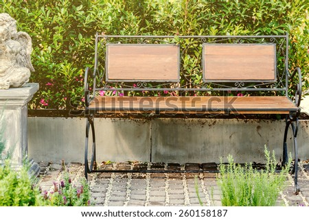 Wood bench decorate in beautiful flower garden