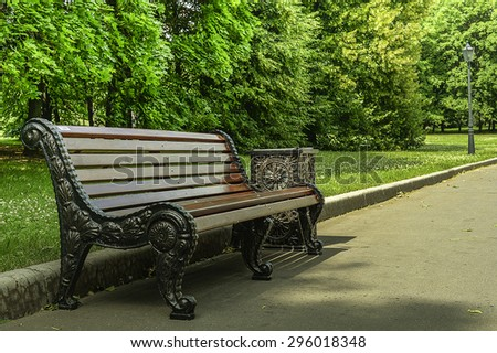 Wood bench in the park - stock photo