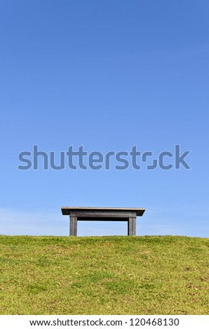 Wood Bench on Green.This photo represents peace.