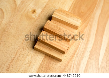 Wood block stacking as step stair with. Business concept.